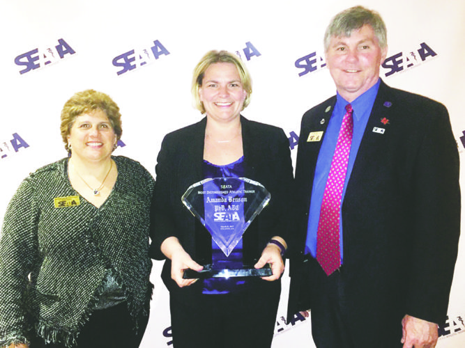 Submitted Photo Dunkirk native, Dr. Amanda Benson, middle, receives the Most Distinguished Athletic Trainer Award from the Southeast Athletic Trainers Association (SEATA).