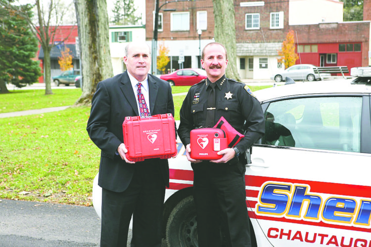 Submitted Photo Univera Healthcare President Art Wingerter, left, is seen with Chautauqua County Sheriff Joseph Gerace.