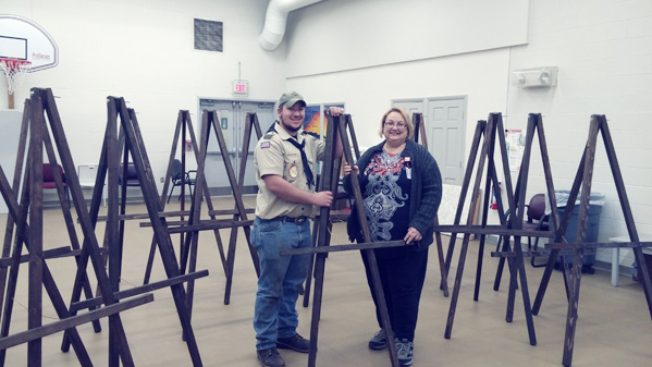 Submitted Photo: Eagle Scout Nick Coggins and Shelly Williamson, a staff member from the Resource Center in Dunkirk are pictured with the easels that were the focus of Nick's Eagle project.