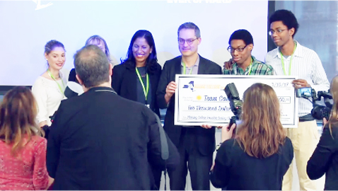 Submitted Photo Receiving their $2,000 check for finishing fourth in the SUNY-wide coding challenge are: (second from right) Kermit B. Mitchell III and (far right) Justin King.