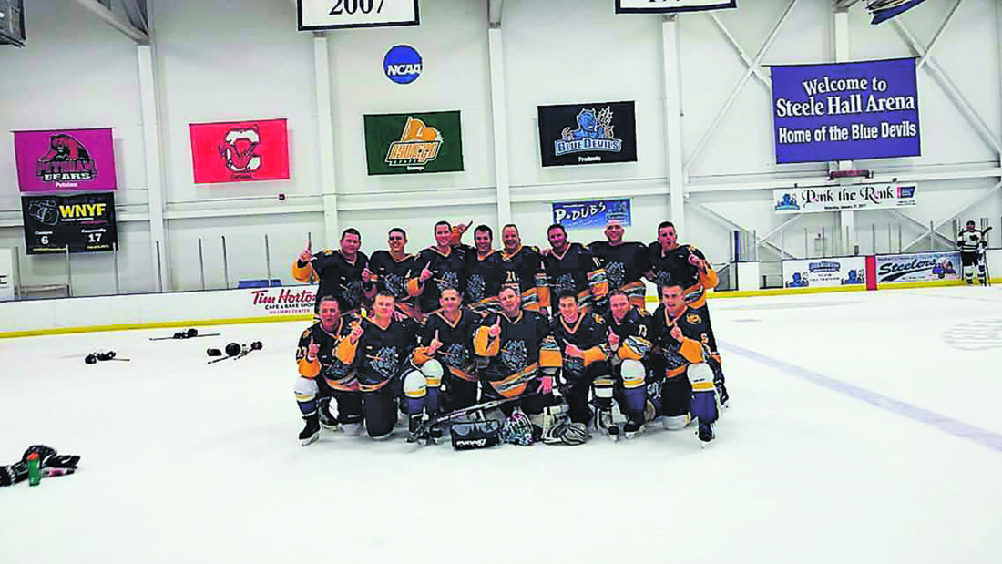 Submitted Photo Lakeview Shock defeated Heenan's, 2-1, to win the CCHA C Division title last week. Pictured above are members of the team.