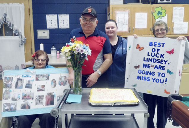 Submitted Photo: The staff and participants at the Dunkirk Adult Day Program recently had a going-away party for one of their friends. The participants surprised staff member Lindsey McQuiggan with a beautiful arrangement of flowers, cards, a picture collage and homemade cake which was made by the participants of the program. Lindsey was a wonderful staff member and friend to all and the participants are going to miss her greatly, although she stated she would visit often. Pictured from left: Dorothy Kacprowicz, Victor Rivera, McQuiggan and Janet Wolcott.