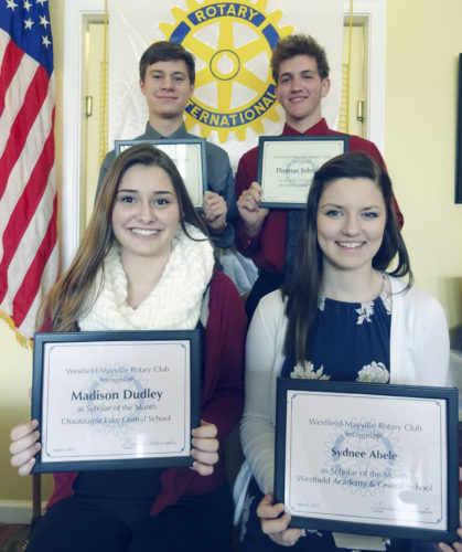 """Submitted Photo  At its March 21 meeting, the Rotary Club of Westfield-Mayville recognized (front, seated, left to right) Madison Dudley of Chautauqua Lake Central School, Sydnee Abele of Westfield Academy and Central School, (back, standing, left to right) Kasen Jewell of Brocton Central School and Thomas Johnston, also of Brocton Central School as """"Scholars of the Month."""""""