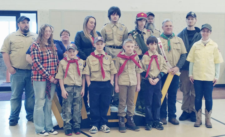 Submitted Photo Silver Creek Cub scout Pack 252 held their annual Blue and Gold banquet on Saturday, Feb. 4. More than 80 guests enjoyed a barbecue lunch at the western-themed banquet. Four Webelo scouts crossed the bridge to Boy Scouts following skits prepared by the younger scouts. Pictured from left are Tristan Carstens, Aiden Nolan, Riley Diate and Elijah Meyer along with their parents. Also in the picture is Scoutmaster of Troop 252, Greg Cole, and members of the troop who welcomed the boys into the troop as they crossed the bridge.