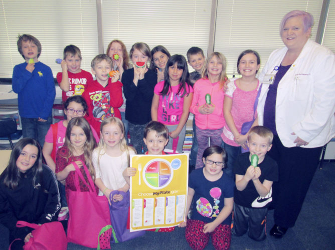 Submitted Photo Mrs. Paula Levandoski's fifth grade class with MyPlate poster.