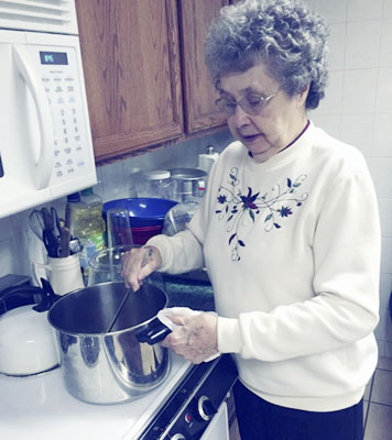 Submitted Photo Shown is Elsie Livermore at the recent Valley Historical Society maple sugar party heating the maple syrup to 232 degrees.