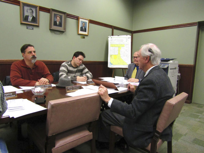 OBSERVER Photo by Greg Fox The Pomfret Town Board discusses a highway vehicle purchase during a recent meeting. Pictured, from left: Councilmen Christopher Schaeffer and John Sedota, Supervisor Donald Steger (back) and Town Attorney Jeffrey Passafaro.