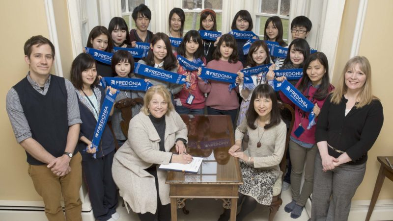 Submitted Photo Fredonia President Virginia Horvath, seated left, and Yumiko Kataoka, right, of Aichi Prefectural University, commemorate an agreement to renew the study abroad agreement between the two universities. They are joined by Aichi students enrolled in short-term study at Fredonia and, from the Office of International Education at Fredonia, Jacob Czelusta, far left, and Dr. Naomi Baldwin, far right.