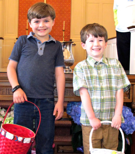 OBSERVER Photo by Rebecca Cuthbert Jackson Spangler, left, and Owen Lukach show off matching Easter grins on Sunday after they hunted down the surprises the Easter Bunny hid for them!