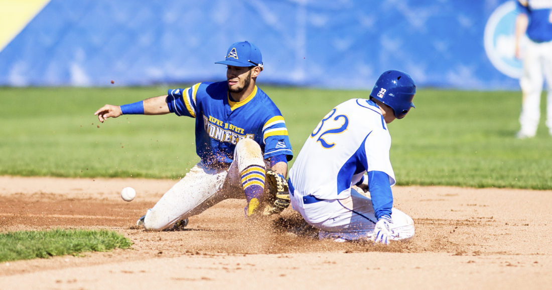 OBSERVER Photo by Ron Szot Fredonia's James Krolikowski (32) beats a throw in front of Alfred State shortstop Andy Pichardo (9) during Monday's game.