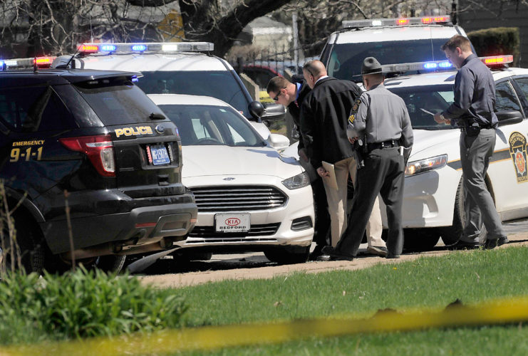 Erie Times-News via AP Pennsylvania State Police look over a car as they investigate the scene where Steve Stephens, the suspect in the random killing of a Cleveland retiree posted on Facebook, was found shot dead Tuesday in Erie. Pa.
