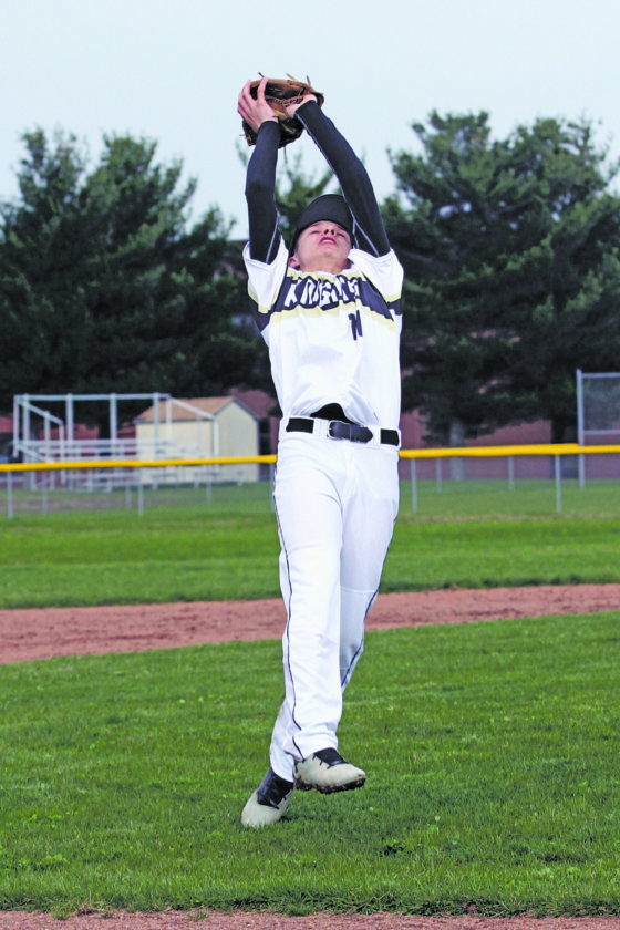 OBSERVERPhotos by Lisa Monacelli Silver Creek pitcher Tom Galfo, pictured above at left, makes a catch during the Black Knights' CCAAWest 1 baseball game against Fredonia on Wednesday. At right is Fredonia center fielder Jake Green making a catch. The game was suspended in the bottom of the third inning due to rain. It will be concluded at a later date.