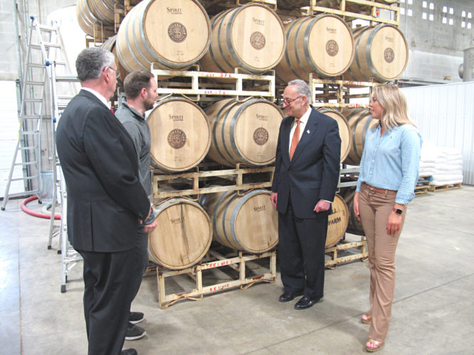 Photo by A.J. Rao. U.S. Sen. Charles Schumer visited the Southern Tier Distilling Company in Lakewood on Wednesday to push for expanded crop insurance for malt barley farmers in Upstate New York. Pictured, from left, are Vince Horrigan, Chautauqua County executive; James Waltz, head distiller at Southern Tier; Schumer; and Kaycee Currie, hospitality manager at Southern Tier.