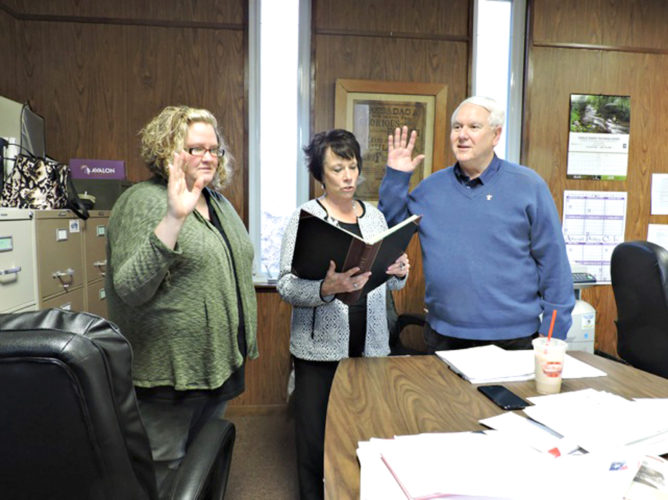 Submitted Photo. John Sipos (right) is sworn in as the Cassadaga historian by Deputy Clerk Bonita Mazzone (left) and Village Clerk Roxanne Astry.