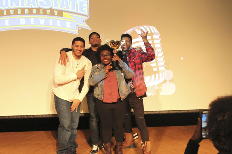 Submitted Photo Celebrating their 2017 Regional Intercollegiate Poetry Slam trophy are (from left): Kanard Lewis, Rajae Barnes-Wright, Stephanie Pierre-Jacques and Devin Johnson.