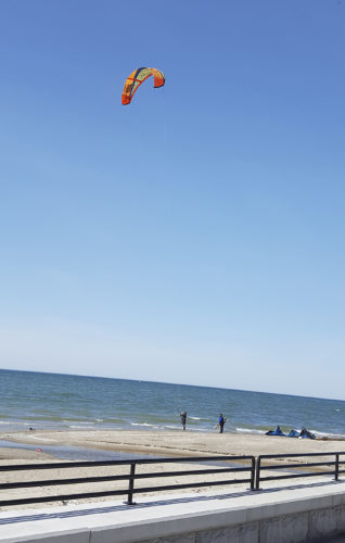 OBSERVER Photo by Nicole Gugino Some fun seekers took advantage of Monday's warm weather by getting out their kite surfing equipment on Main Street Beach in Dunkirk.