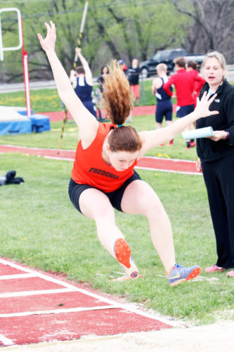 OBSERVER Photo by Lisa Monacelli Fredonia's Georgie Gens competes in the long jump during Tuesday's track and field meet against Southwestern. Gens won the long jump and earned two additional first-place finishes.