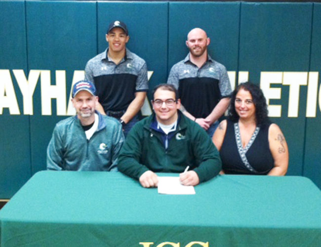 Submitted Photo Flanked by his parents, Patrick and Kathy, Dunkirk High School senior Nick Jones signs his letter of intent to continue his academic and wrestling career at Jamestown Community College. Standing, from the left, are Jamestown Community College head coach Kris Schimek and Jamestown Community College assistant coach Ryan Guynup. P-J photo by Scott Kindberg
