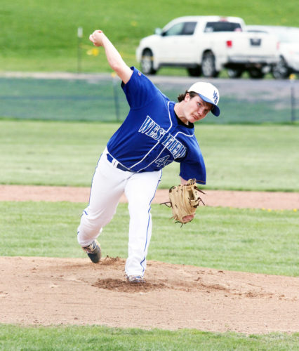 OBSERVER Photo by Mary Ann Wiberg Westfield's Brock Schuster delivers a pitch during the Wolverines' victory over  Clymer Tuesday.