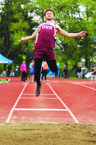 OBSERVERPhotos by Roger Coda: Dunkirk's Issiah Velez is seen competing in the long jump. Though Velez had an impressive jump of 18-feet-9-inches, he was chosen as the track Most Valuable Player.