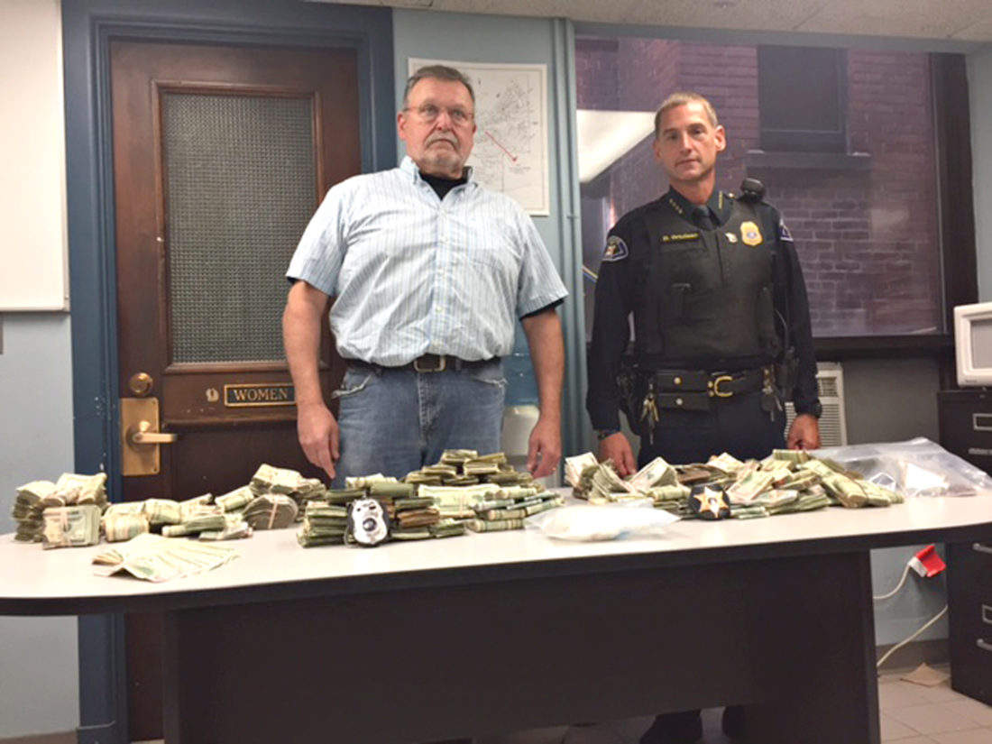 Submitted Photo. Chautauqua County Sheriff's Lt. David Bentley (left) of the Southern Tier Regional Drug Task Force and Dunkirk Police Chief David Ortolano display money and crack cocaine seized during a drug raid Friday at 51 E. Second St. in the city.