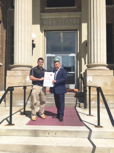 Submitted Photo D.C. Delivery owner Joshua Kubera is seen with Dunkirk Mayor Willie Rosas. D.C Delivery enables Dunkirk/Fredonia residents to have their favorite food from local food establishments delivered right to their doorstep, beach or park.