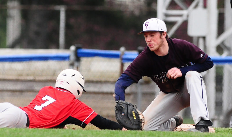 Photo by Scott Reagle Chautauqua Lake first baseman Tyler Meredith attempts a tag on Maple Grove's Dalton Dubois.