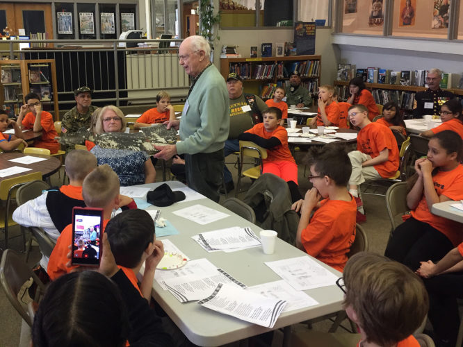 Veteran Robert Swift showed Jefferson Middle School fifth graders a piece of the airplane that he bailed out of during WWII. Submitted photos