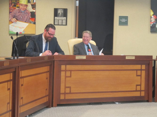 At left, Patrick Slagle, Jamestown Board of Education vice president, and Superintendent Tim Mains thanked the Jamestown Teachers Association for their hard work during contract negotiations, which lasted more than two years. The board unanimously approved a new contract for the teachers Thursday night.
