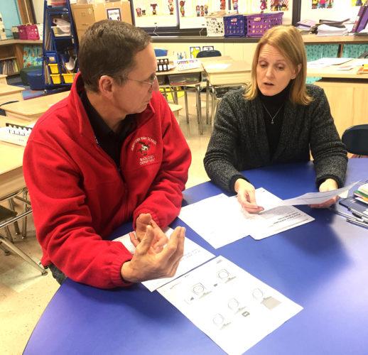 Picture at left: JPS Social Studies Curriculum Coach Jeff Kresge works with Washington Middle School sixth grade teacher Joel Sopak.