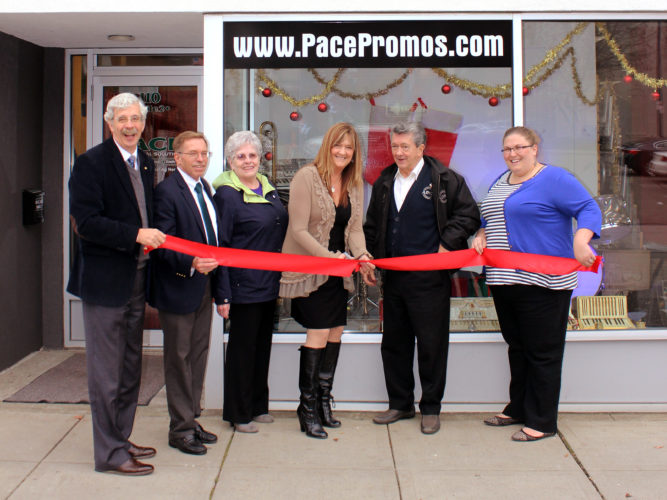Caryn Pace, center, is joined by local dignitaries, representatives and proponents of local small businesses during a ribbon-cutting ceremony celebrating the grand opening of her new business, Pace Promotional Solutions, on Monday. Submitted photo