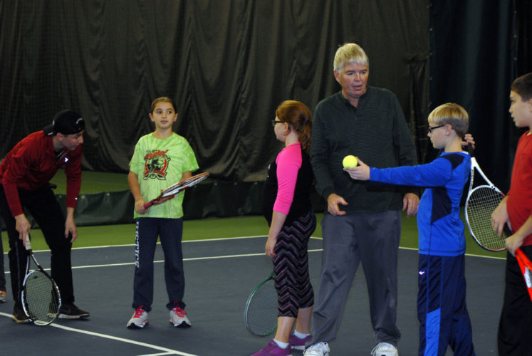 Tom Anderson, center, Lakewood YMCA branch manager for 25 years now is pictured assisting young tennis players in fine-tuning their tennis skill sets, at the Jamestown Area YMCA's Paul Bush branch. Submitted photos