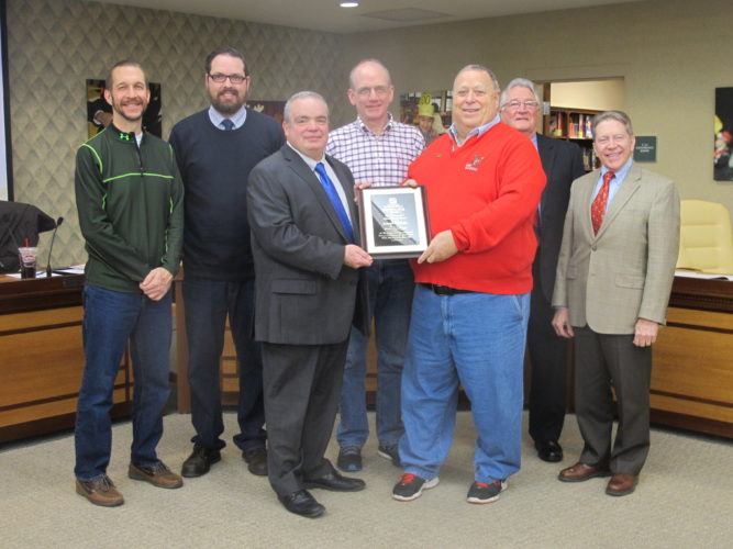 Joe DiMaio, former Jamestown Board of Education president, stopped by the school board meeting Tuesday to present an award to the board. DiMaio was awarded the New York State School Boards Association Everett R. Dyer Award for Distinguished School Board Service and decided to share it with his former colleagues.  P-J photo by Katrina Fuller