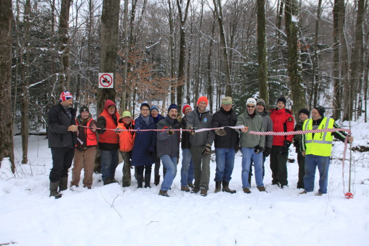 "Officials of the Boutwell Hill Ski Club, state Department of Conservation and Chautauqua Rails To Trails, as well as volunteers and supporters, cut the ribbon on the new ""Homestead Trail."" Missing from photo is Randy Sweeney of the Chautauqua Region Community Foundation. Submitted photo"