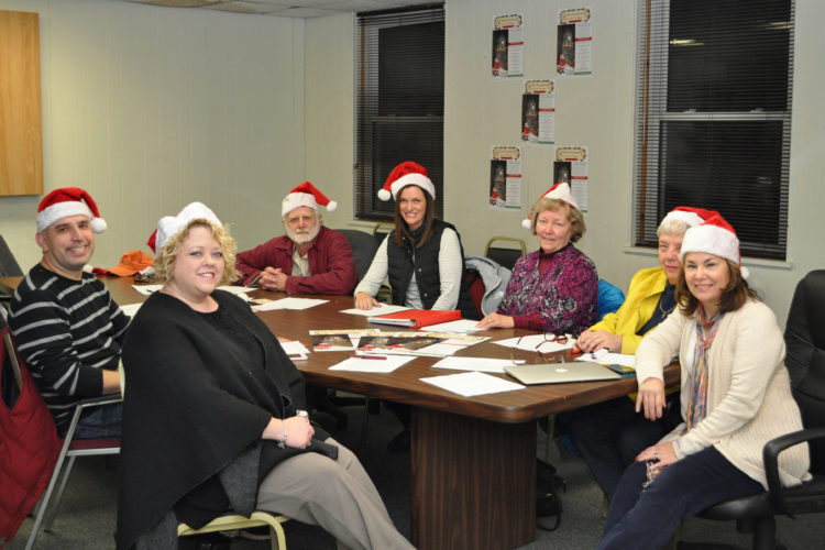 Some members of the Village of Lakewood's Events and Marketing Committee prepare for the Christmas in the Village event open to the public from noon to 8 p.m. Saturday. The holiday extravaganza will include shopping, dining and family activities with over 100 participating businesses. Submitted photo
