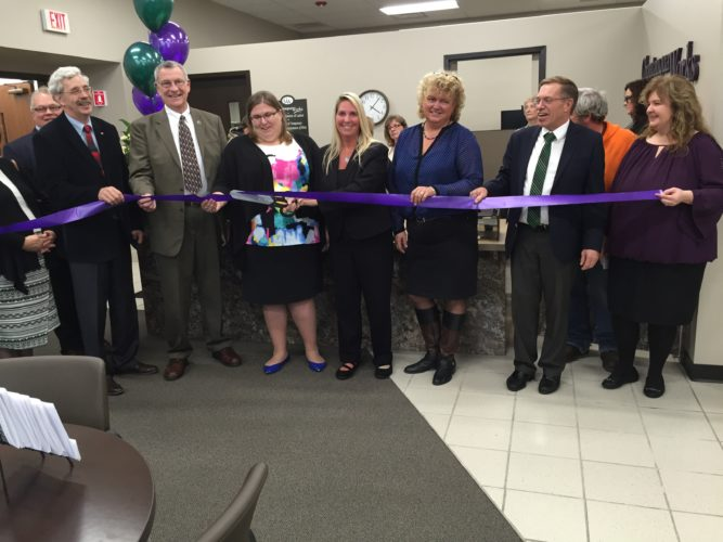 From left is Kevin Muldowney, Andy Goodell, Vince Horrigan, Jacqueline Phelps, Katie Geise, Jody Cheney, Greg Lindquist and Cheryl Calhoun during the ribbon cutting ceremony for the new Chautauqua Works Workforce Development Board location at the Signature Center, 4 E. Third St., Jamestown. Submitted photo