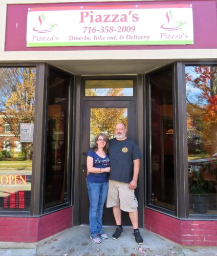Randolph welcomes Bill Piazza and Kelly Becker of Frewsburg who recently opened Piazza's, their new restaurant located at 143 Main St. People will discover this is not a typical pizzeria when they take a look at the menu. Shown are Bill Piazza and Kelly Becker in front of their restaurant. P-J photo by Deb Everts