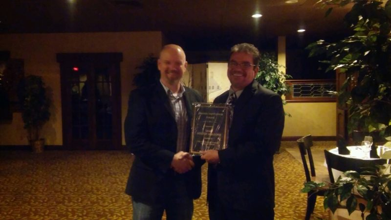 Ken Shearer, Mayville/Chautauqua Community Chamber of Commerce president, presenting the Business Improvement Award to Bryan Muecke, Camp Mission Meadows executive director, at the chamber's annual banquet and meeting at Olives Restaurant Nov. 10. Submitted photo