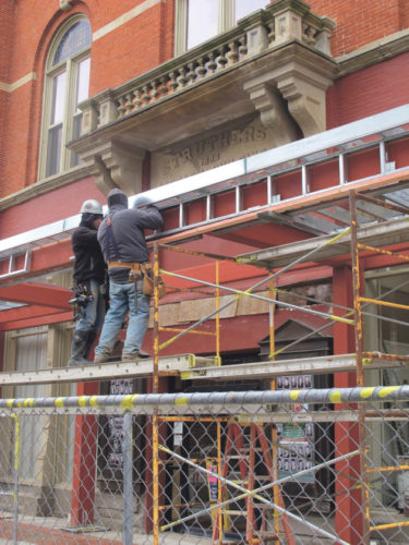 Workers from G.L. Olson of Dewittville erect framing on the new Struthers Library Theatre marquee. P-J photo by Brian Ferry