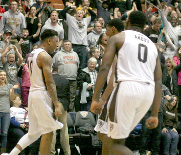 St. Bonaventure's Jaylen Adams, left, celebrates with teammates after connecting on a driving layup with 14 seconds remaining in Saturday's non-conference basketball game against the University of North Carolina-Wilmington at the Reilly Center. Adams made the free throw to complete the three-point play that gave the Bonnies the lead, but UNCW's Denzel Ingram's jump shot with two seconds left gave the Seahawks the win. P-J photo by Cody Crandall