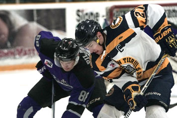 Luke Grossman of the Southern Tier Xpress battles for possession of the puck with a Roc City player during Saturday's NA3HL game at Northwest Arena. P-J photo by Chad Ecklof