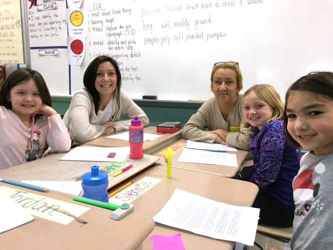 Adrianna Genco, Scarlett Hepler (Jayla Johnson's Aunt), Caryn Hepler (Jayla's grandmother), Jayla Johnson and Siena Loomis participated in a Thanksgiving close reading activity in Corey Brown's third grade classroom.