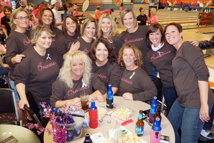 Survivor and Framed in Pink - Bowling Over Breast Cancer volunteer Mary Jo Salvaggio, center front, is surrounded by her teammates at the October 2016 fund raising event.