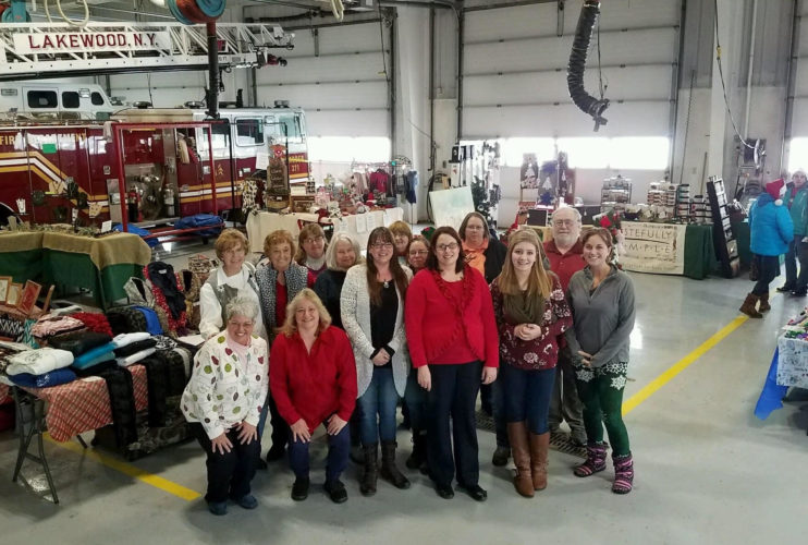 Some of the 60 plus vendors at Christmas in the Village pose for a group picture at the Lakewood Fire Department.