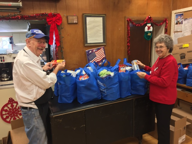 Shown putting items in the bags for delivery are Wally Jozwiak, chef of the 76ers Meals on Wheels kitchen, and Elsie Livermore, site manager. For more information on the program, call 962-3455.   Submitted photo