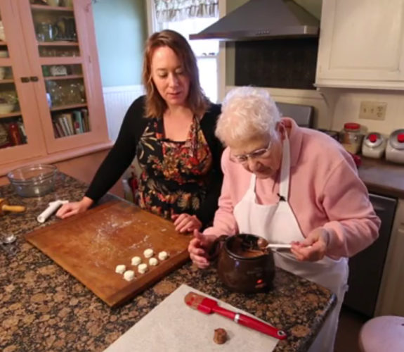 Sarah Tranum and her grandmother, Mabel, along with the various components of their newly conceived product, Grandma Mabel's Chocolate Candy Kit. Tranum is currently operating a Kickstarter campaign to fund a test run of 1,000 kits that she can take to various retailers to gauge public interest in the product. Submitted photo