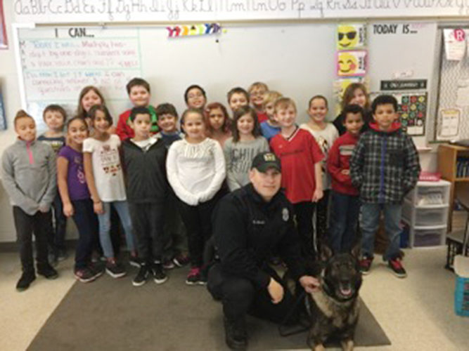 Students at Ring Elementary School recently thanked the Jamestown Police Department and K-9 Mitchell. The students made 60 handmade thin blue line ornaments for each officer and a collar for Mitchell.  Submitted photo