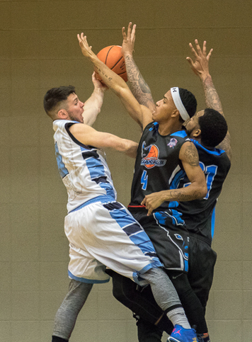 Jamestown's Jose Davila (4) and Oswinn Hines (31) block a pass from DuBois' Nick Anderson during Sunday's Premier Basketball League game at Jamestown Community College's Physical Education Complex. P-J photo by AlexShipherd