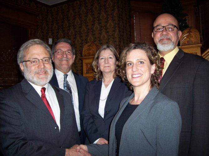 Attorneys of the Fessenden, Laumer and DeAngelo law firm congratulate Gregory Yaw on his retirement. Yaw recently retired and sold his practice to Fessenden, Laumer and DeAngelo. From left are Yaw; Charles DeAngelo; Mary Schiller; Galena Duba-Weaver; and Daniel Gullotti. Submitted photo