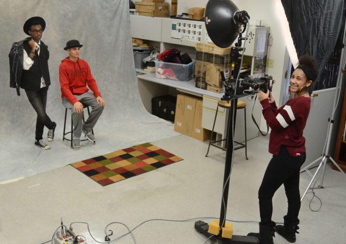 JHS photographers, Donald Karr III, Jayden Schultz and Y'Monie Miller worked in the JHS portrait studio during Digital Photography.